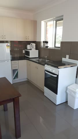 Private Kitchen with tea and coffee facilities and all appliances - Microwave, kettle, oven, toaster, Nespresso coffee maker (and pods!), fridge, and all the utensils and things you might need as well :)