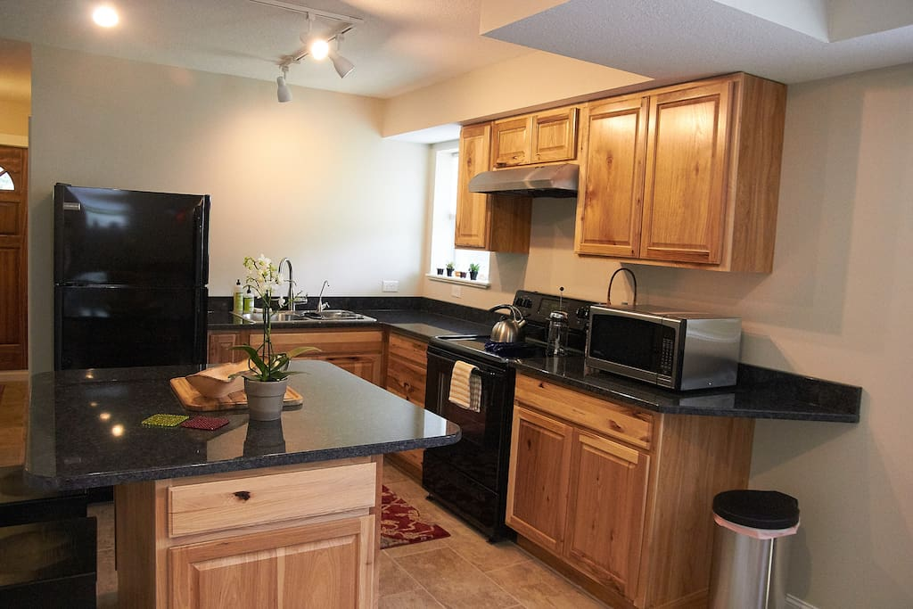 Full kitchen with granite countertops