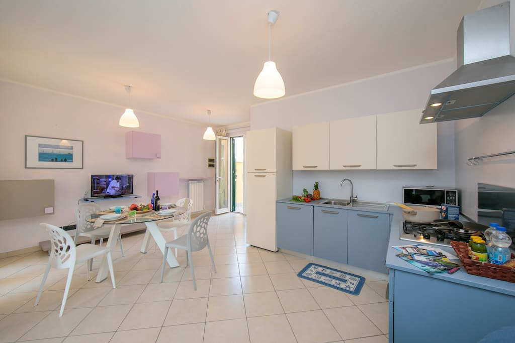 Bright Living room and fully equipped kitchen