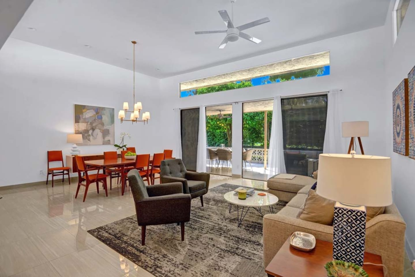 LIVING ROOM TO DINING ROOM - Oranj Palm Vacation Homes