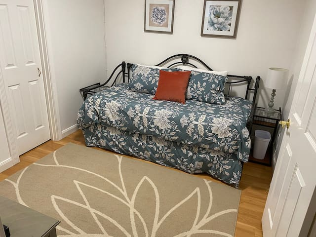 Second bedroom with comfortable trundle bed.