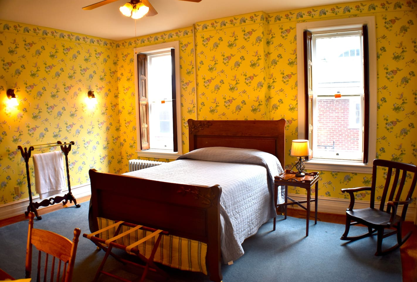 This private room features a comfortable full size bed that is perfect for your visit!