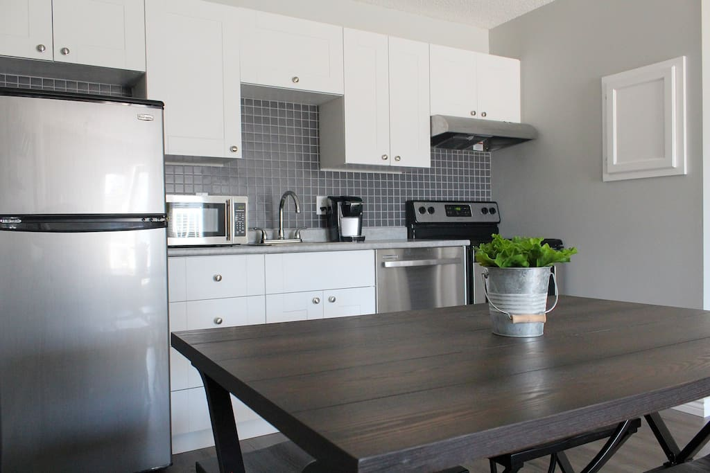 Updated kitchen with stainless steel appliances and Keurig