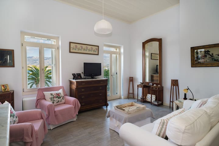 The elegant living room offers unobstructed sea views while the double glazed windows provide soundproofing