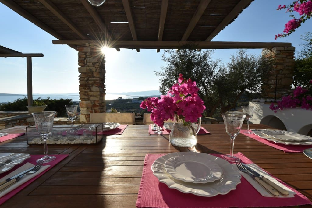 Dining table on the terrace viewing the sea during sunset