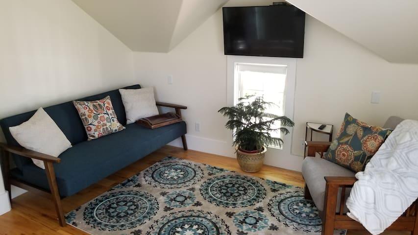 sitting area with fold down sleeper sofa,  lounge chair, TV