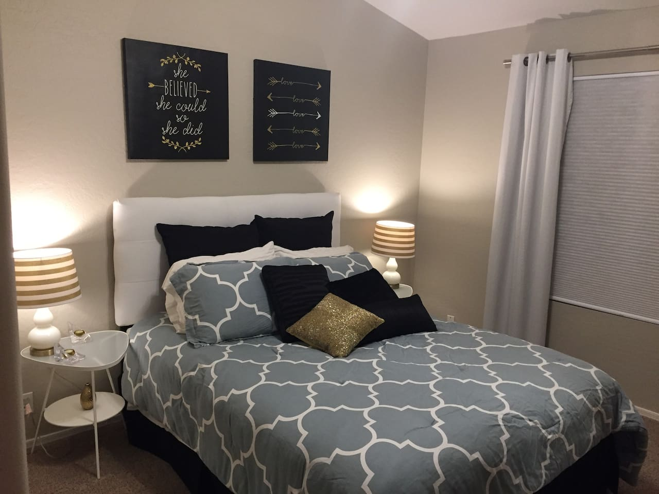 Luxurious bedroom with a queen size bed, dresser, large closet with storage, room darkening drapes, ceiling light with fan, lockable door and your private bathroom right across the hall.