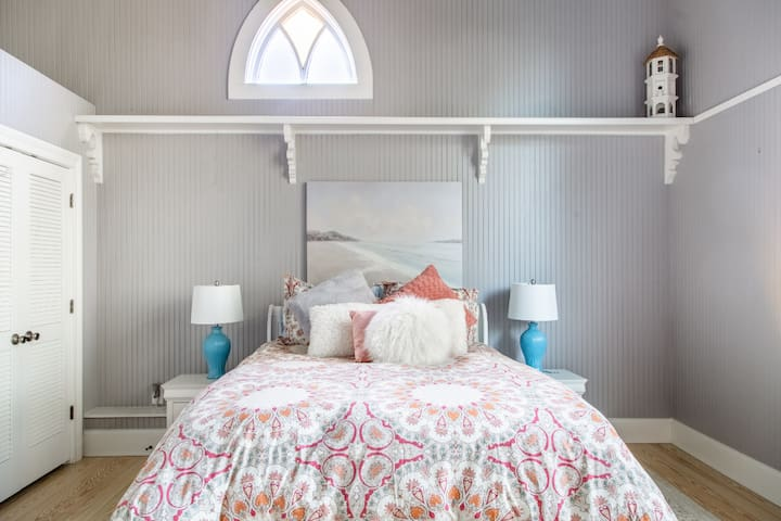 The bedroom features a luxurious queen pillowtop mattress and high-end linens for a great night's sleep