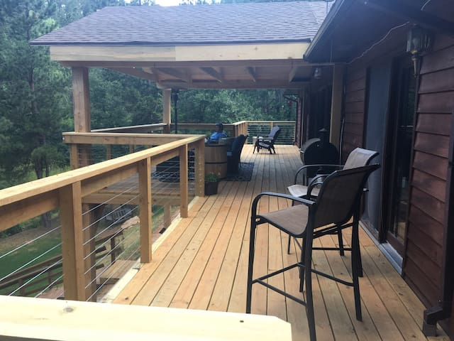 Patio Area with trawler grill, patio furniture, propane heater, satellite TV, sit in the sun or shade