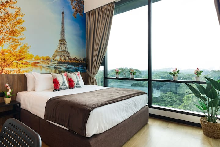 A lovely day in Paris - let the master bedroom transport you to the heights of romance at the Eiffel Tower amidst splendid foliage and refreshing greenery!