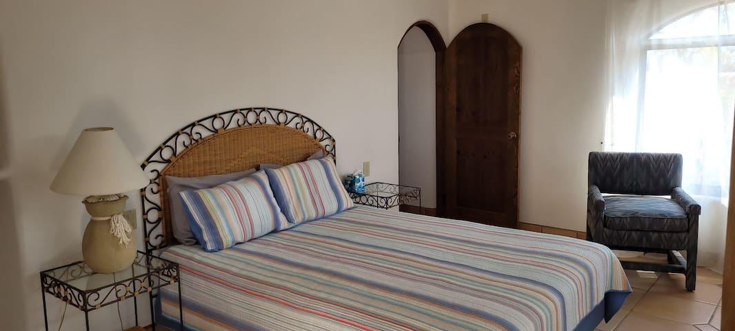 Queen size guest bedroom.
