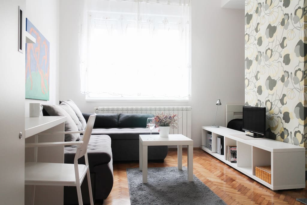Bright clean room with lot of functions practically organized for your pleasure