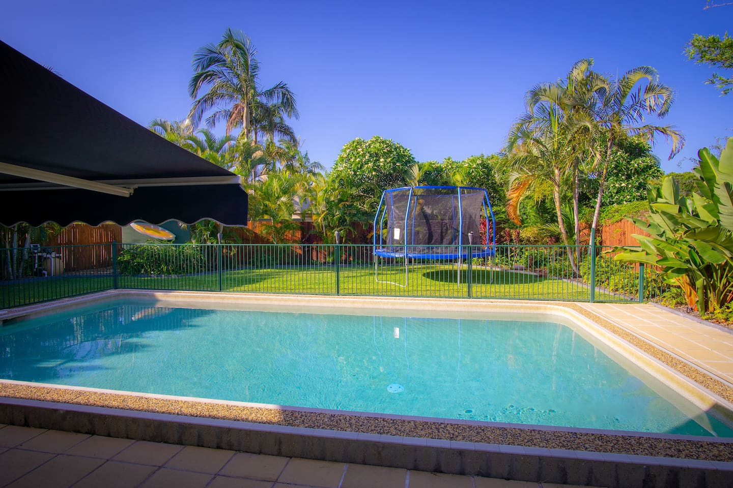 Our beautiful pool and secure fenced backyard with trampoline provides space for kids and pets to play