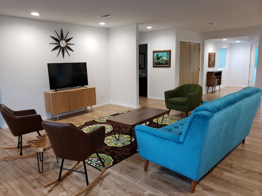 Mid-century modern living area. Television has access to Direct TV Now app as well as Amazon Prime or log in to your own favorite streaming apps.