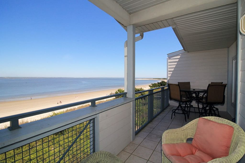 Enjoy Watching the Dolphins Frolicking in the Waters of the Savannah River Entrance and Atlantic Ocean from your Private Balcony