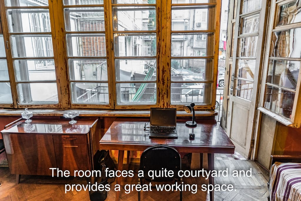The room faces a quite courtyard and provides a great working space.