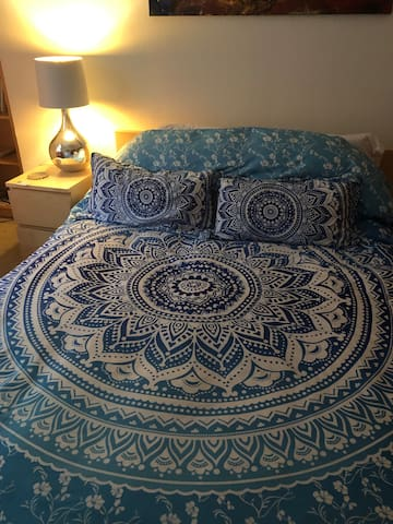 Bedroom with comforter for the winter season.