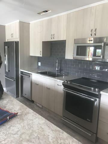 Full kitchen, washer, dryer