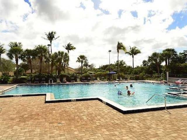 large fenced community pool