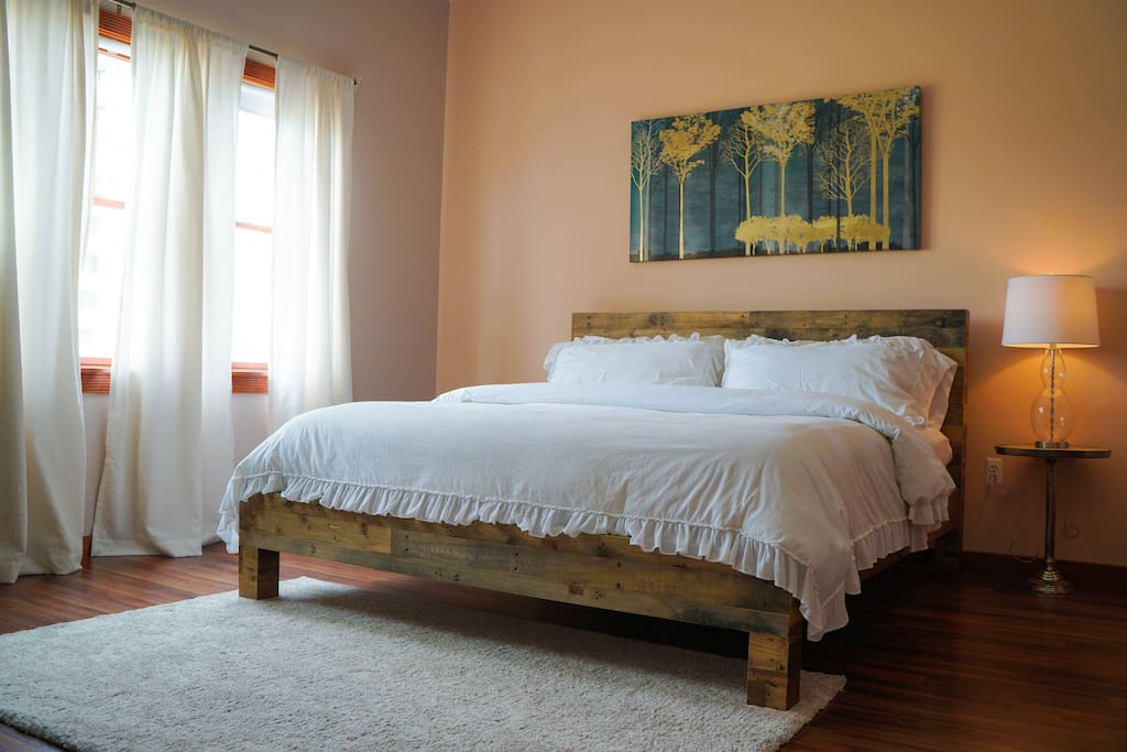 Master bedroom with a king size comfy bed