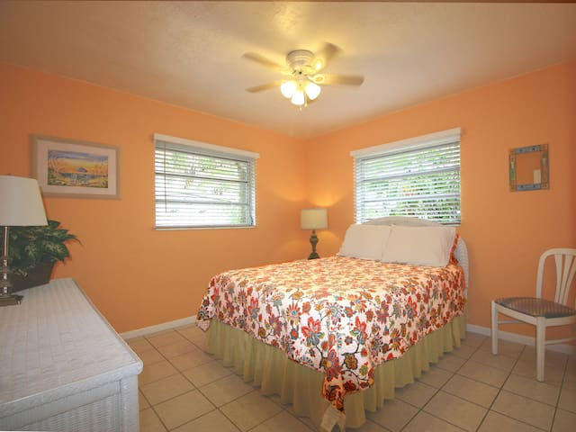 Queen bed in the second bedroom.  Ceiling fans, plenty of storage, tiled floors throughout the cottage.