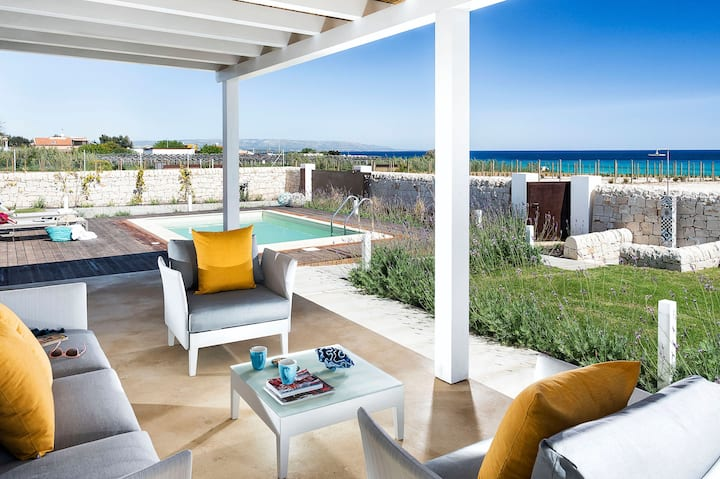 Multiple adjacent villas with private heated pool each, by the sea