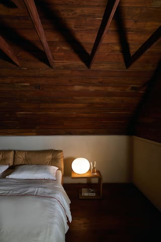 The Queen-size bed in the Attic Room.