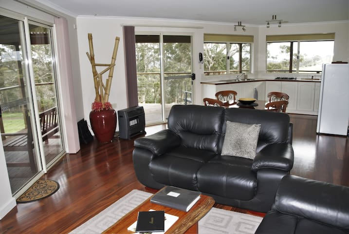 Spacious open plan living area with a view to die for.