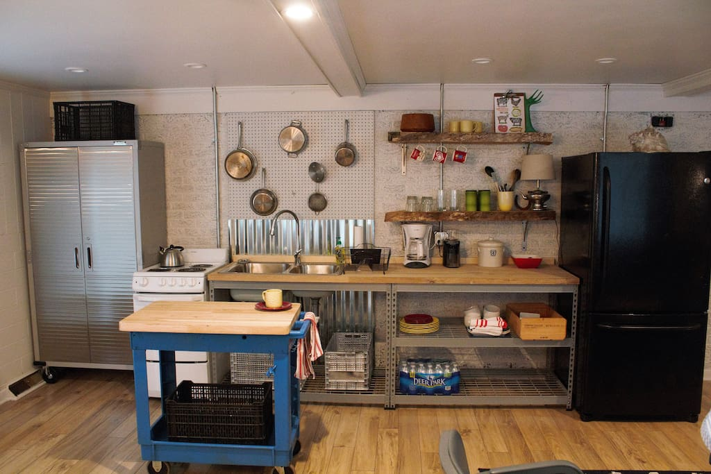 Industrial kitchenette. Oodles of counter space, and charm to boot!