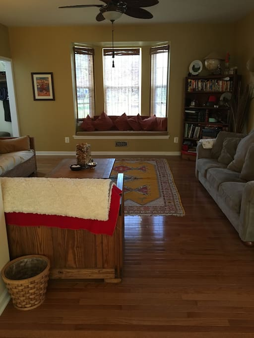 Front room, with window seat with 3 couches, adjacent to the dining room