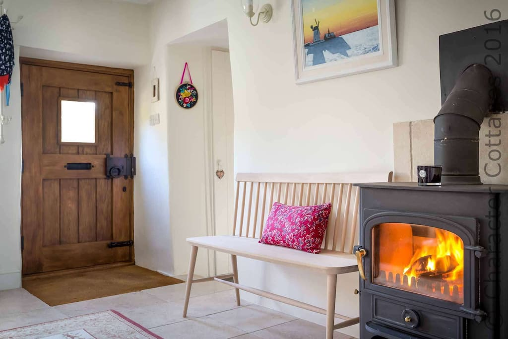 Step into the welcoming hallway, complete with wood-burner