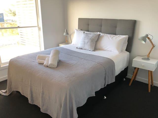 Queen bed in the second bedroom with en-suite