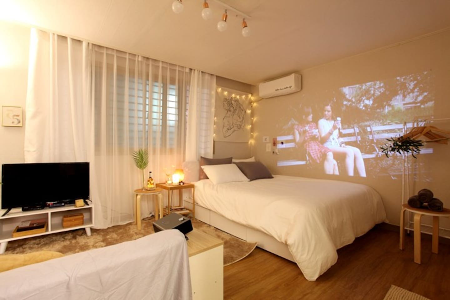 Queen bed and Beam projector and TV