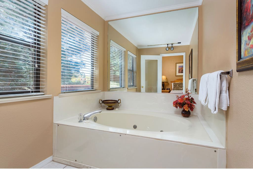 Generously-sized with a soothing whirlpool tub, the master bath is relaxing