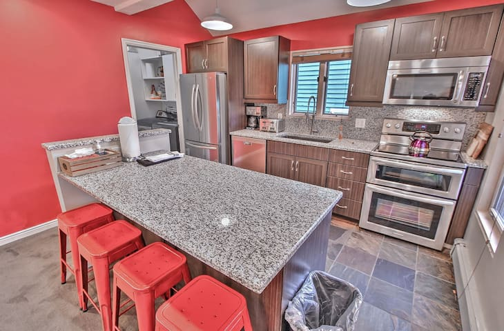 Lower Kitchen with Stainless Steel Appliances, including Electric range with Double Ovens, Granite Counters and Kitchen Bar Seating