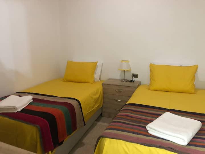 Casa Los Pimientos. Twin room 1 w/shared bathroom.