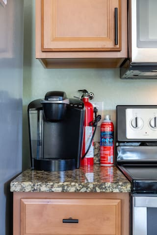 Keurig coffee make, coffee pods, and cream is provided.