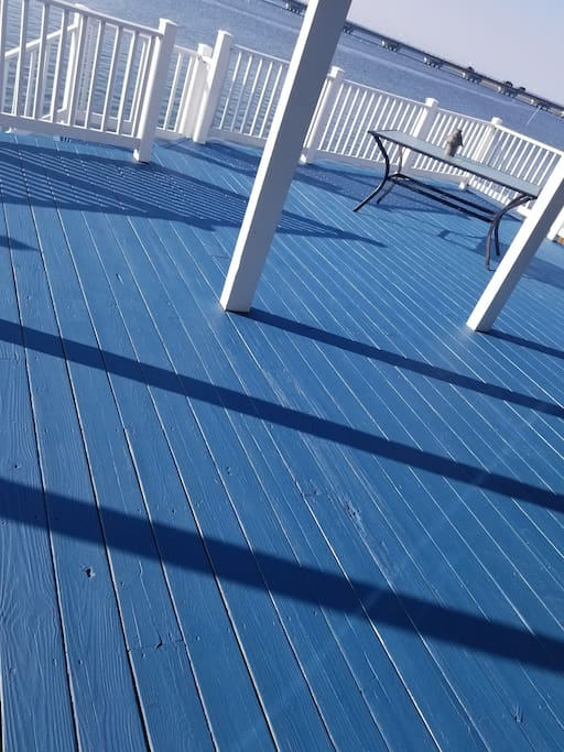 freshly painted deck overlooking the water