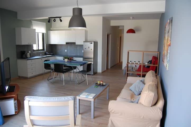 Brand new in-town apartment with private yard