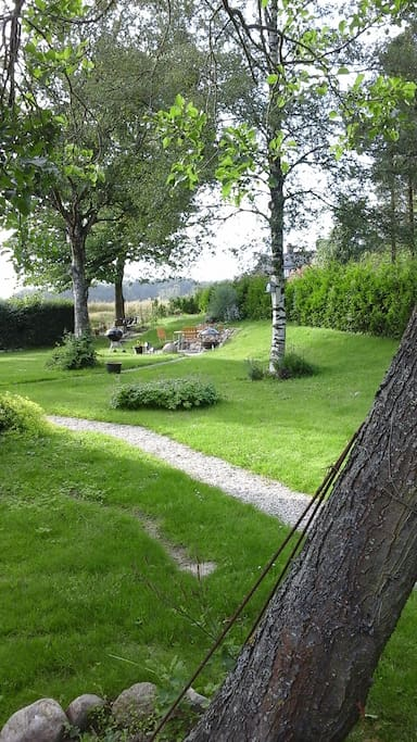 Access to garden with barbecue facilities and fire belongig to main house.