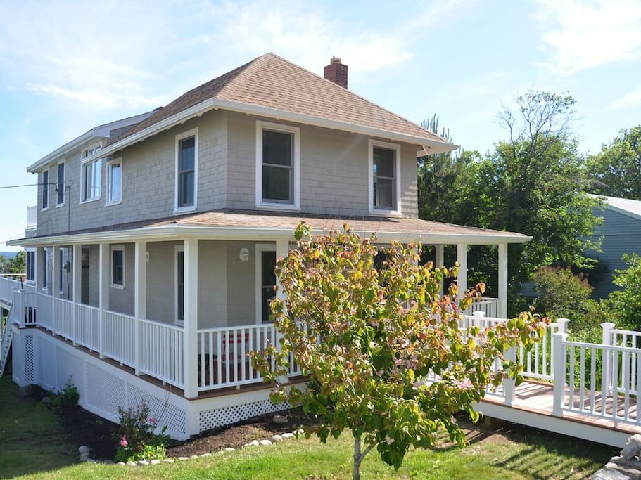Golden Cottage with brand new decks, railing and paint.