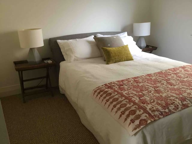 Bedroom 2 has a queen size bed with air conditioning, ceiling fan and full built ins.
