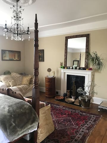Room from doorway - showing sofa and fireplace