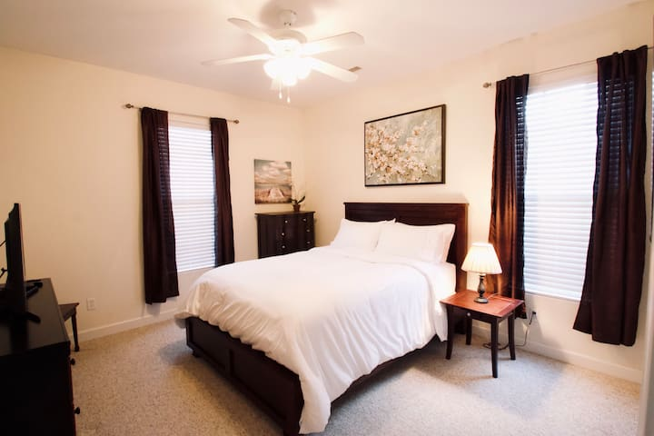 Master Bedroom (only bedroom on main level).  Queen bed.  Attached master bathroom with shower (no bathtub).