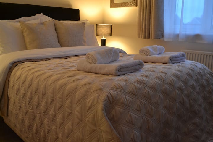 Cosy double bedroom with ambient lighting