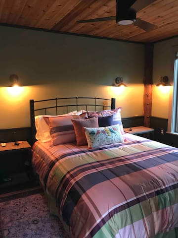 Queen Size Bed In the First Floor Cabin
