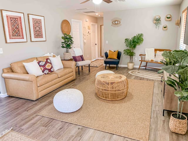 Spacious living room with plenty of seating, 65 inch smart TV with Amazon Fire stick, YouTube TV & Netflix included. This couch converts into a full sized bed.