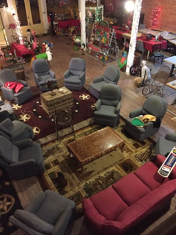 11 recliners creating a homey feel to visit or watch movies on the large 100x100 screen!