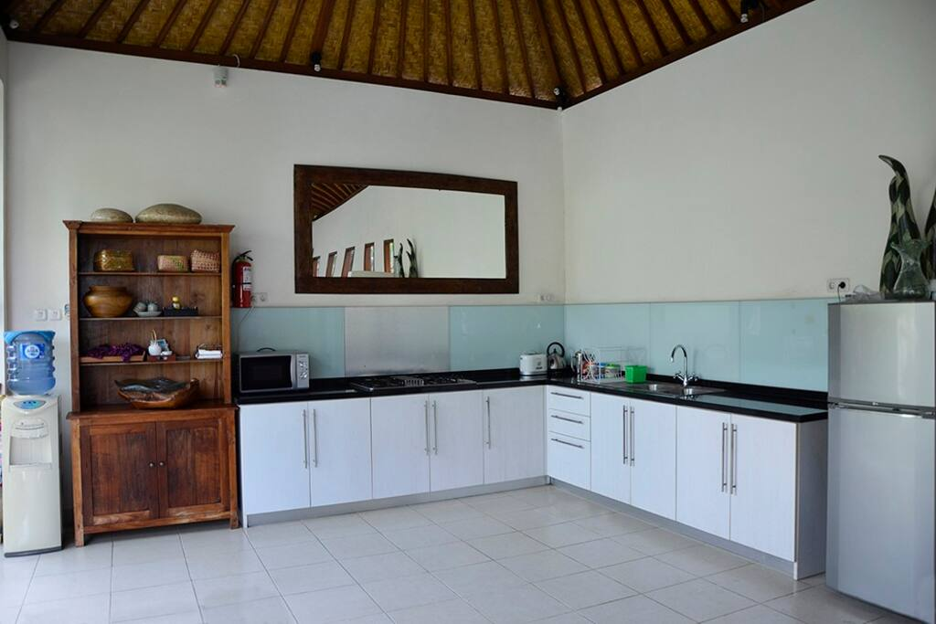The fully equipped kitchen is ready for you to use. Breakfast is prepared there daily.
