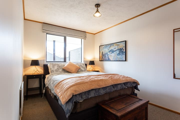 Comfy, warm queen size bed in the bedroom.